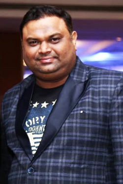 Dinesh Maghudia - Founder - Sync Entertainment